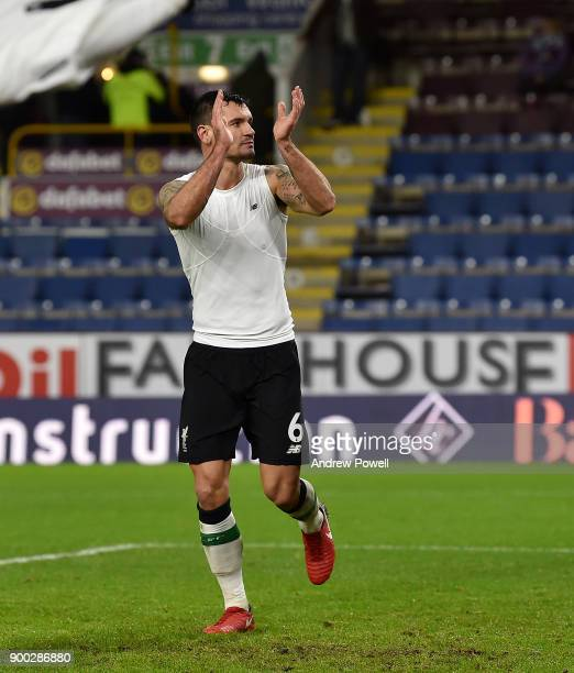 Dejan Lovren of Liverpool shows his appreciation to the fans at the end of the Premier League match between Burnley and Liverpool at Turf Moor on...