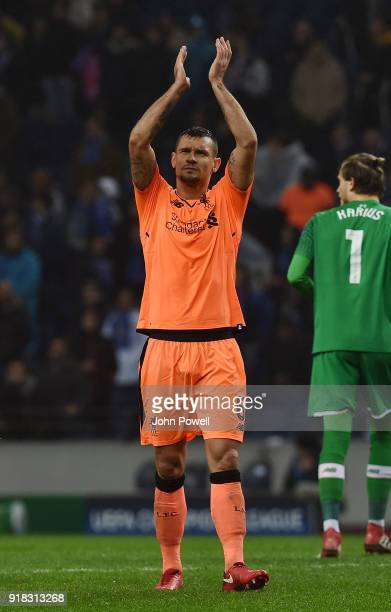 Dejan Lovren of Liverpool shows his appreciation to the fans at the end of the UEFA Champions League Round of 16 First Leg match between FC Porto and...