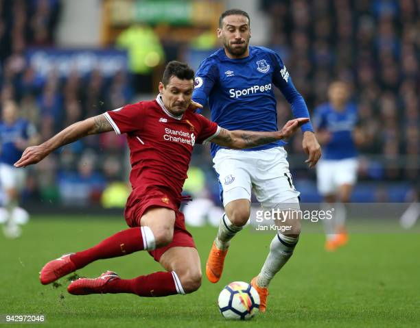 Dejan Lovren of Liverpool tackles Cenk Tosun of Everton during the Premier League match between Everton and Liverpool at Goodison Park on April 7...