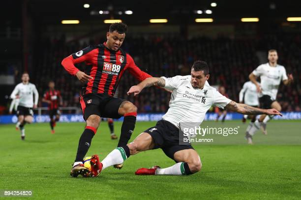 Dejan Lovren of Liverpool tackles Joshua King of AFC Bournemouth during the Premier League match between AFC Bournemouth and Liverpool at Vitality...