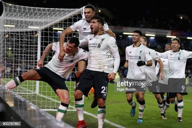 Dejan Lovren of Liverpool Trent Alex Arnold of Liverpool and Emre Can of Liverpool celebrate there sides second goal of the game during the Premier...