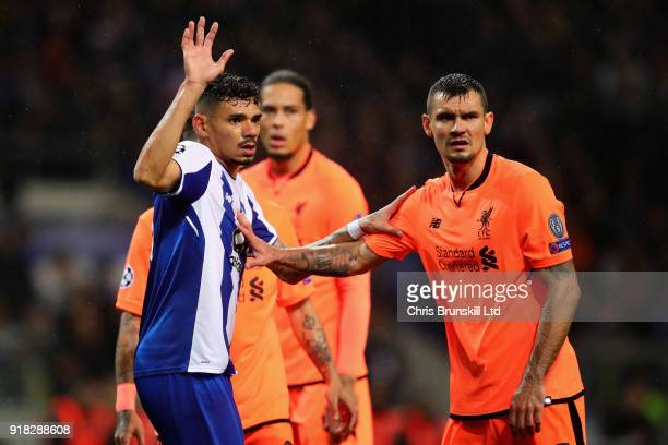 Dejan Lovren of Liverpool tussles with Diego Reyes of FC Porto during the UEFA Champions League Round of 16 First Leg match between FC Porto and...
