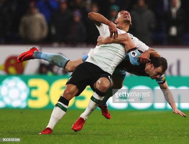 Dejan Lovren of Liverpool vies with Ashley Barnes of Burnley during the Premier League match between Burnley and Liverpool at Turf Moor on January 1...