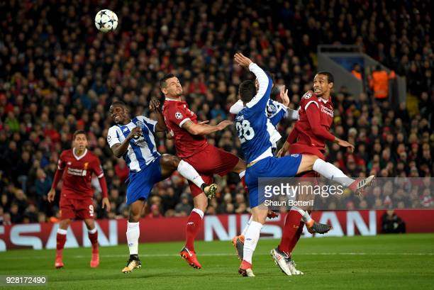 Dejan Lovren of Liverpool wins a header during the UEFA Champions League Round of 16 Second Leg match between Liverpool and FC Porto at Anfield on...
