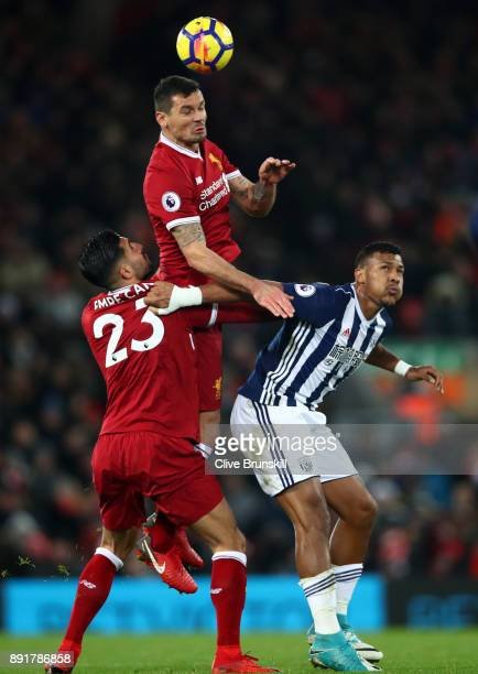 Dejan Lovren of Liverpool wins a header over Jose Salomon Rondon of West Bromwich Albion during the Premier League match between Liverpool and West...