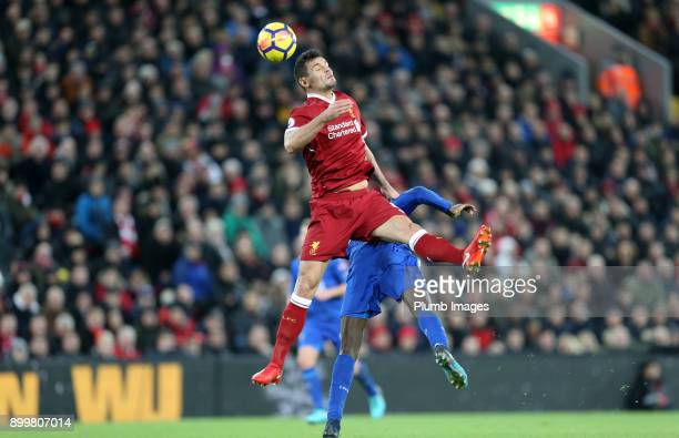 Dejan Lovren of Liverpool wins the header during the Premier League match between Liverpool and Leicester City at Anfield on December 30th 2017 in...
