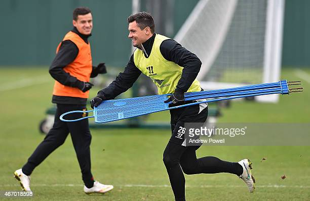 Dejan Lovren of Liverpool with a mannequin during a training session at Melwood Training Ground on March 20 2015 in Liverpool England