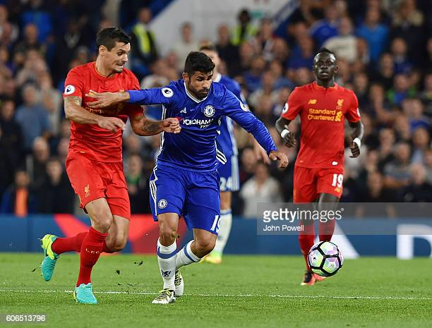 Dejan Lovren of Liverpool with Diego Costa of Chelsea during the Premier League match between Chelsea and Liverpool at Stamford Bridge on September...