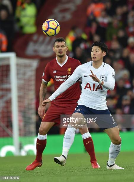 Dejan Lovren of Liverpool with HeungMin Son of Tottenham during the Premier League match between Liverpool and Tottenham Hotspur at Anfield on...