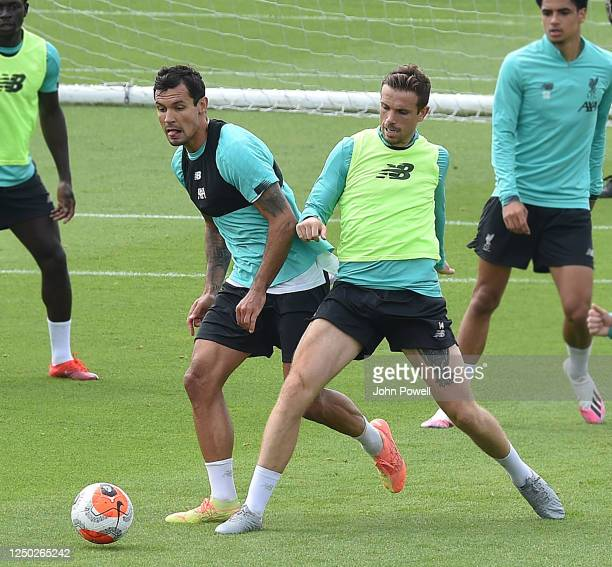 Dejan Lovren of Liverpool with Jordan Henderson captain of Liverpoolduring a training session at Melwood Training Ground on June 17 2020 in Liverpool...