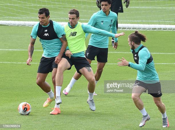 Dejan Lovren of Liverpool with Jordan Henderson captain of Liverpool during a training session at Melwood Training Ground on June 17 2020 in...