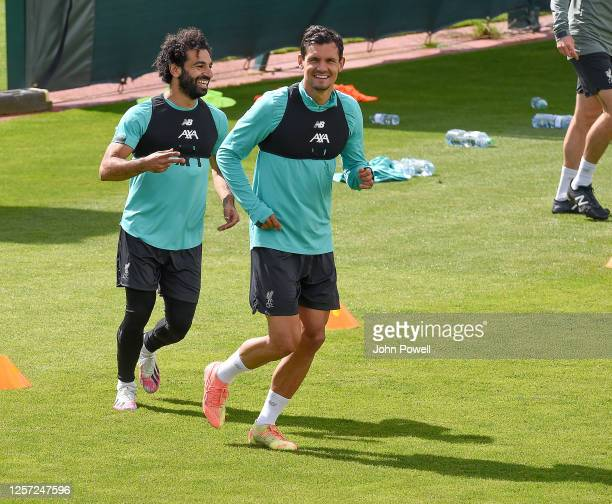 Dejan Lovren of Liverpool with Mohamed Salah of Liverpool during a training session at Melwood Training Ground on July 20 2020 in Liverpool England