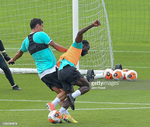 Dejan Lovren of Liverpool with Naby Keita of Liverpool during a training session at Melwood Training Ground on June 17 2020 in Liverpool England