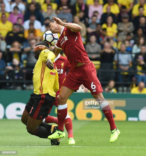 Dejan Lovren of Liverpool with Stefano Okaka during the Premier League match between Watford and Liverpool at Vicarage Road on August 12 2017 in...