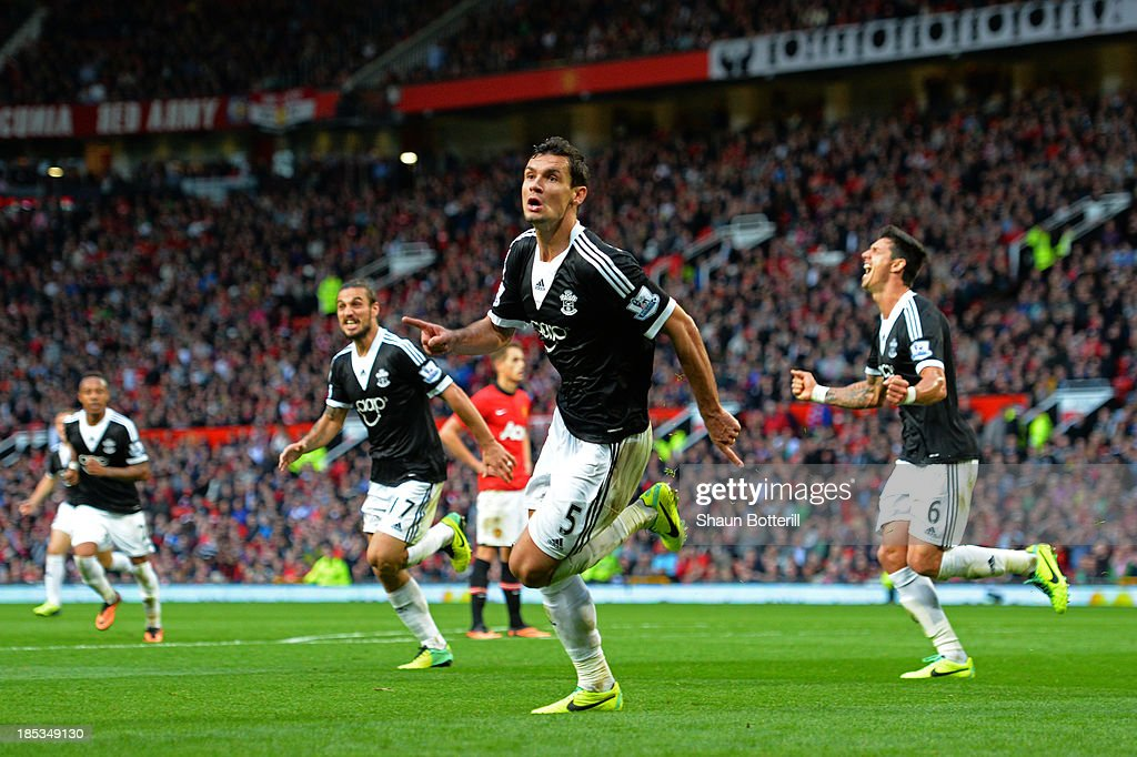 Dejan Lovren of Southampton celebrates after scoring a late goal to level the scores at 1-1 during the Barclays Premier League match between Manchester United and Southampton at Old Trafford on October 19, 2013 in Manchester, England.