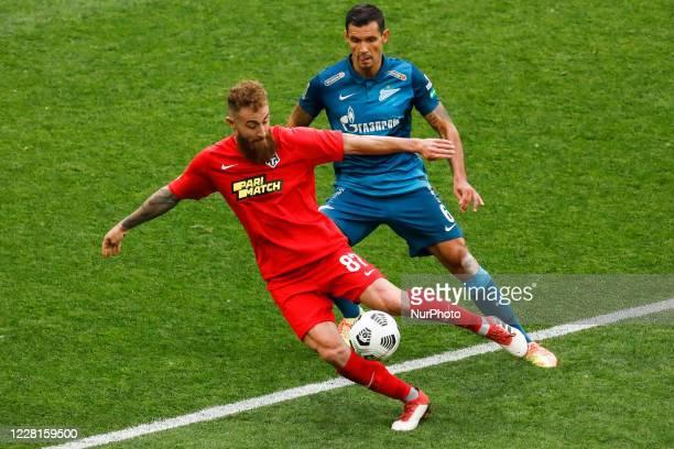 Dejan Lovren of Zenit Saint Petersburg and Aleksandre Karapetian of Tambov vie for the ball during the Russian Premier League match between FC Zenit...