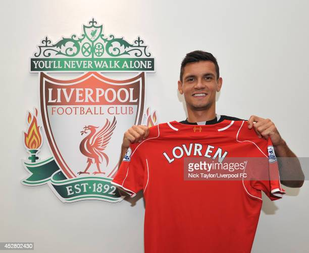 Dejan Lovren poses as he is unveiled as a new signing for Liverpool Football Club at Melwood Training Ground on July 26 2014 in Liverpool England