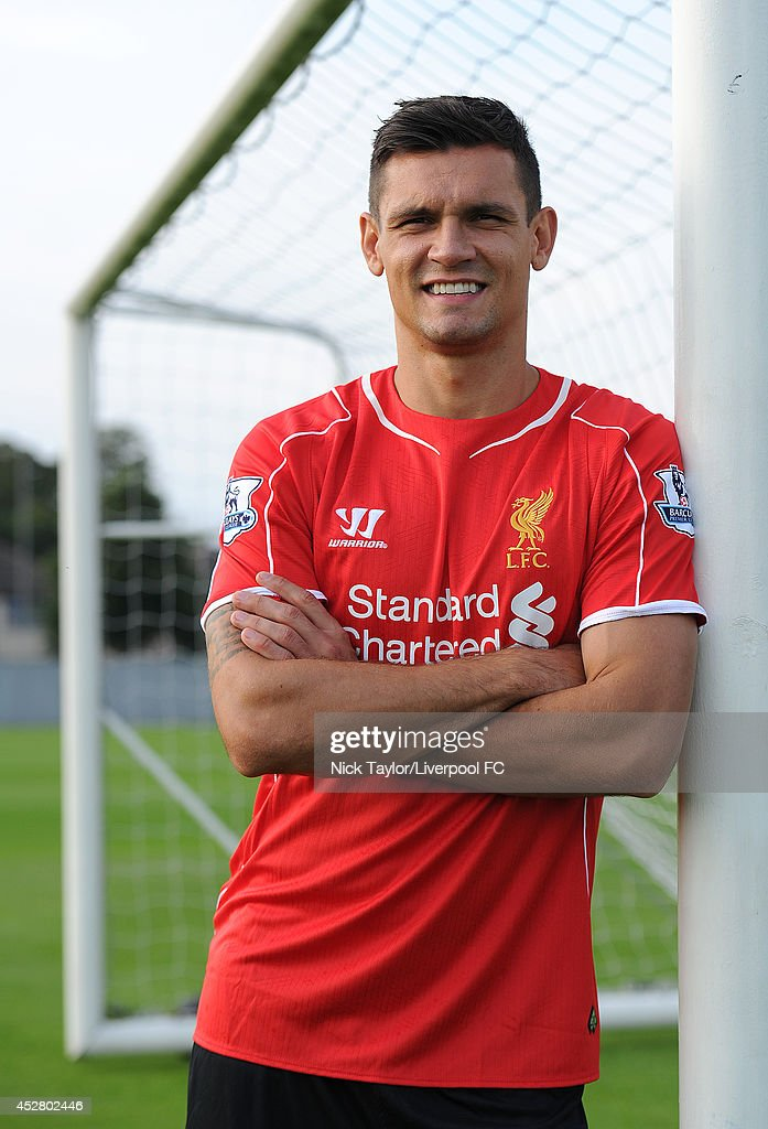 (PREMIUM PRICING APPLIES) (MINIMUM PRINT/BROADCAST FEE OF GBP 150, ONLINE FEE OF GBP 75 PER IMAGE, OR LOCAL EQUIVALENT) Dejan Lovren poses as he is unveiled as a new signing for Liverpool Football Club at Melwood Training Ground on July 26, 2014 in Liverpool, England.