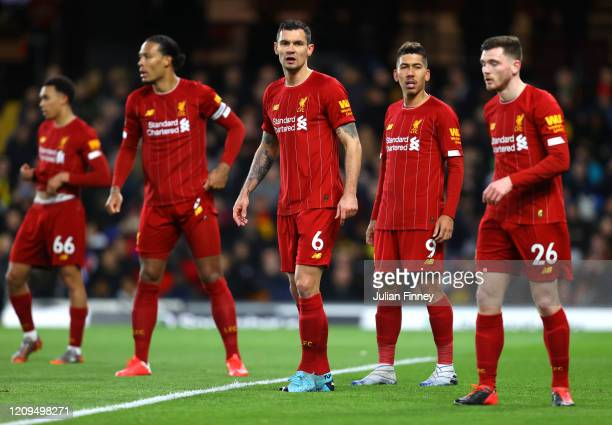 Dejan Lovren Roberto Firmino and Andy Robertson of Liverpool look on during the Premier League match between Watford FC and Liverpool FC at Vicarage...