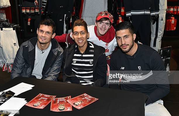 Dejan Lovren Roberto Firmino and Emre Can of Liverpool at a signing session for competition winners at Liverpool One Club Shop on November 19 2015 in...