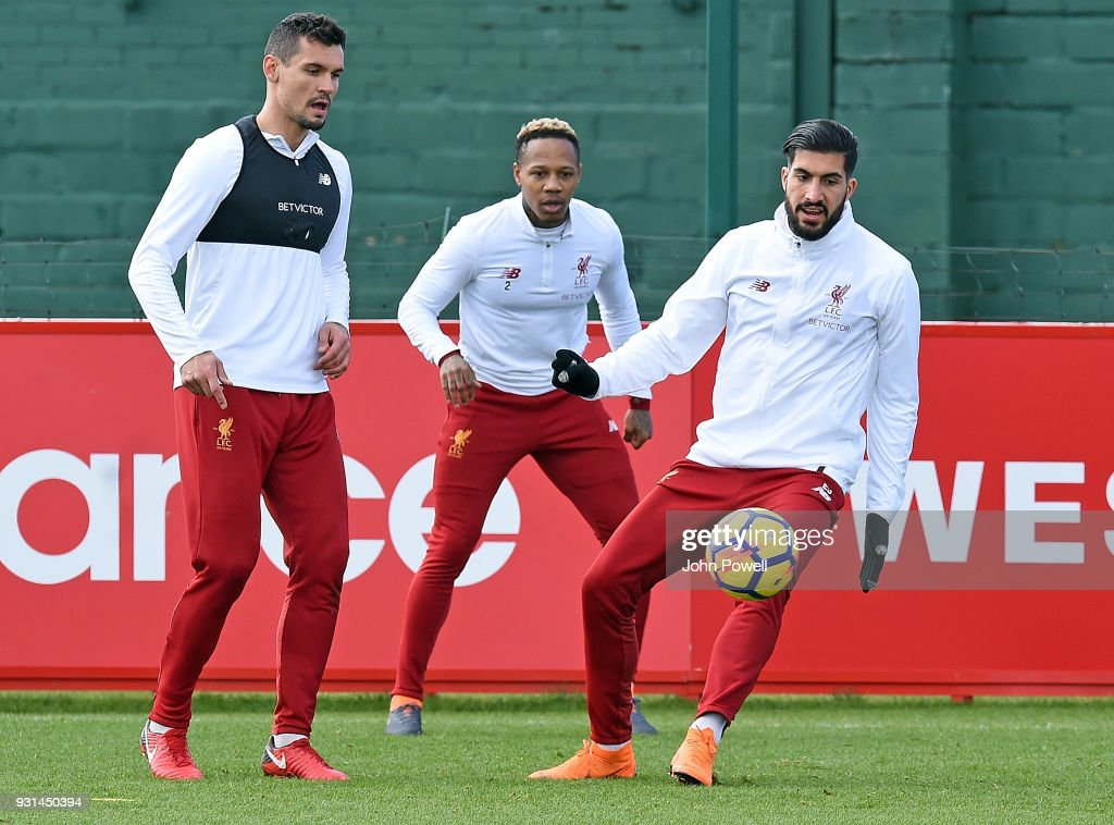 Dejan Lovren with Emre Can and Nathaniel Clyne of Liverpool during a training session at Melwood Training Ground on March 13, 2018 in Liverpool, England.