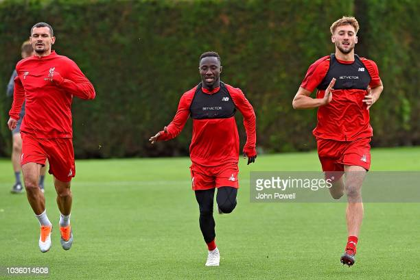 Dejan Lovren with Naby Keita and Nathaniel Phillips of Liverpool during a training session at Melwood on September 19 2018 in Liverpool England