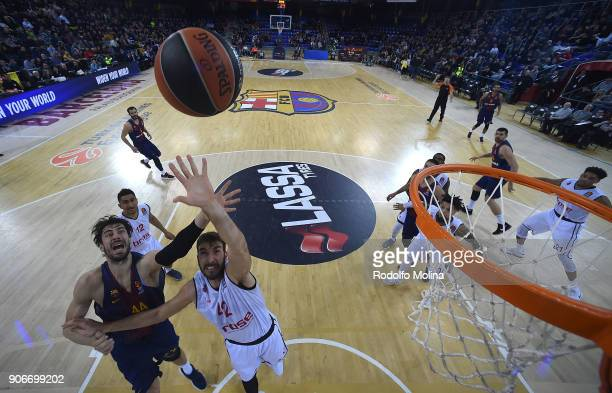 Dejan Musli #42 of Brose Bamberg competes with Ante Tomic #44 of FC Barcelona Lassa during the 2017/2018 Turkish Airlines EuroLeague Regular Season...