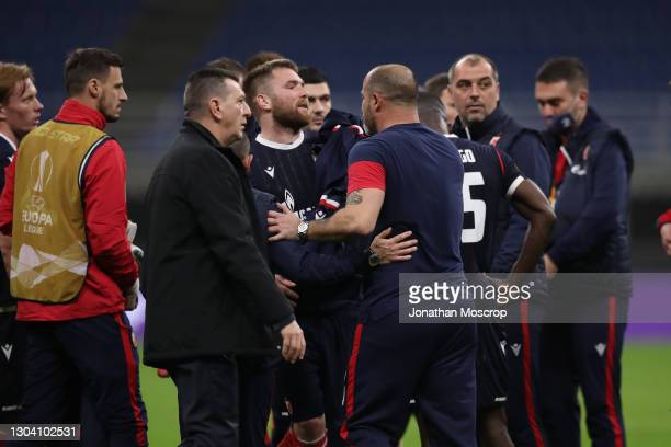 Dejan Stankovic Head coach of FK Crvena zvezda pulls his players caway from the officials following the ifnal whistle of the UEFA Europa League Round...