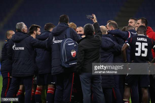 Dejan Stankovic Head coach of FK Crvena zvezda speaks with his players following the final whistle of the UEFA Europa League Round of 32 match...