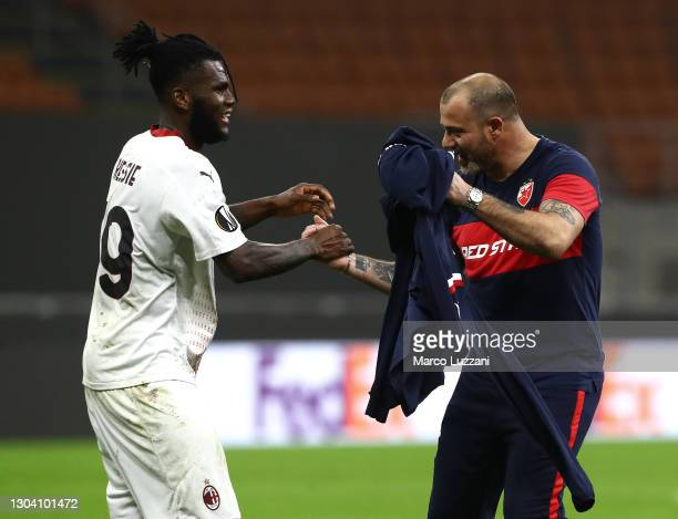 Dejan Stankovic, Head Coach of Red Star Belgrade celebrates with Franck Kessie of Milan after the UEFA Europa League Round of 32 match between AC...