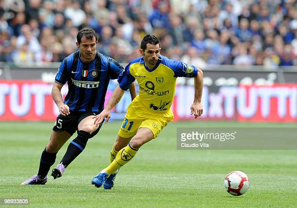 Dejan Stankovic of FC Internazionale Milano competes for the ball with Sergio Pellissier of AC Chievo Verona during the Serie A match between FC...