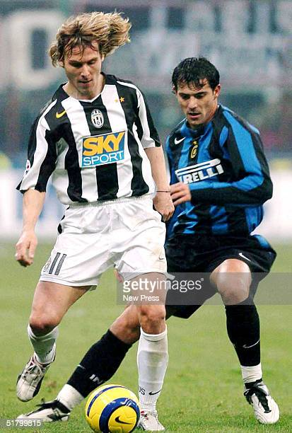 Dejan Stankovic of Inter Milan fights for the ball with Pavel Nedved of Juventus on November 28 2004 in Milan Italy