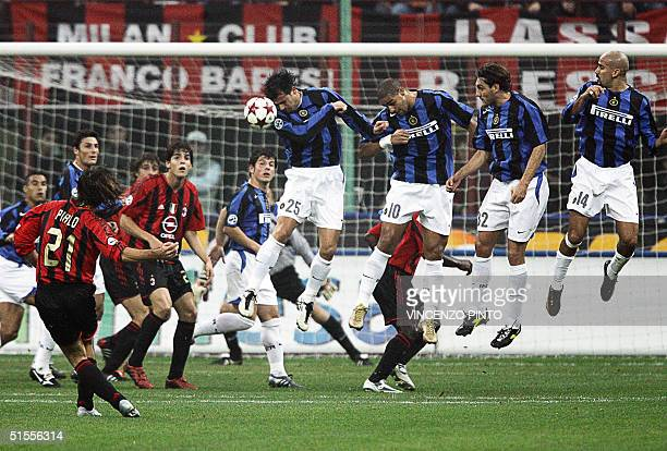 Dejan Stankovic of InterMilan controls a free kick by Andrea Pirlo of AC Milan during their Italian Serie A football match at Meazza stadium in Milan...