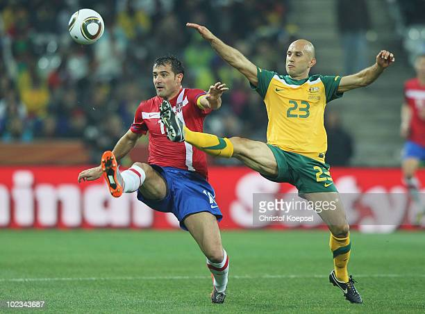 Dejan Stankovic of Serbia and Marco Bresciano of Australia battle for the ball during the 2010 FIFA World Cup South Africa Group D match between...