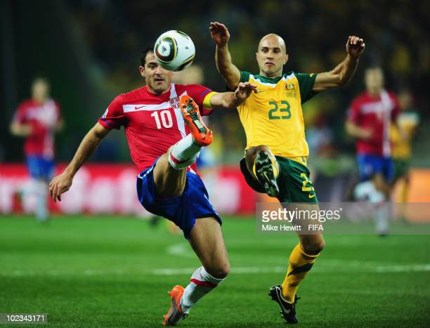 Dejan Stankovic of Serbia and Marco Bresciano of Australia tussle during the 2010 FIFA World Cup South Africa Group D match between Australia and...