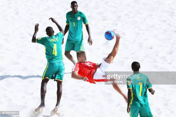 Dejan Stankovic of Switzerland attempts a bicycle kick between Papa Ndour Mamadou Sylla and Babacar Fall of Senegal during the FIFA Beach Soccer...