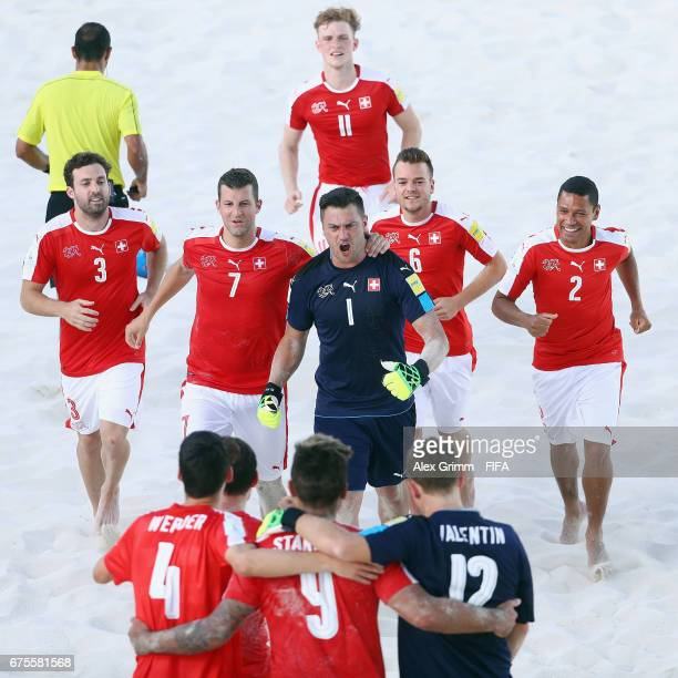 Dejan Stankovic of Switzerland celebrates with team mates after winning the penalty shootout of the FIFA Beach Soccer World Cup Bahamas 2017 group A...