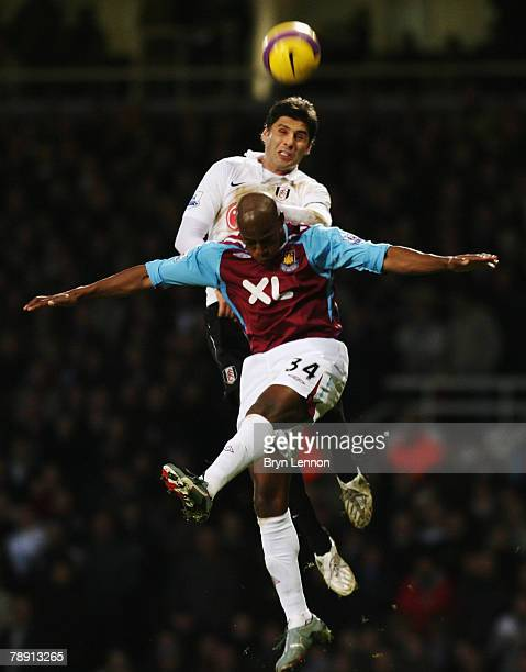 Dejan Stefanovic of Fulham rises above Luis Boa Morte of West Ham United during the Barclays Premier League match between West Ham United and Fulham...