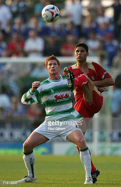 Dejan Stefanovic of Portsmouth battles for the ball with Matthew Harrold of Yeovil Town during a pre-season friendly match between Yeovil Town and...