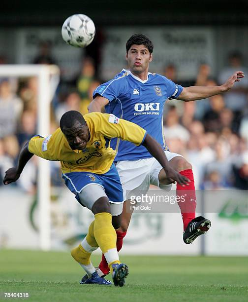 Dejan Stefanovic of Portsmouth gets tackled by Richard Pacquette of Havant & Waterlooville during a Pre-Season Friendly match between Havant &...