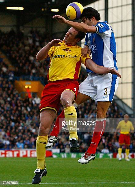 Dejan Stefanovic of Portsmouth heads the ball away from of Malky Mackay of Watford during the Barclays Premiership match between Portsmouth and...