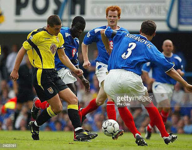 Dejan Stefanovic of Portsmouth stops Gareth Barry of Aston Villa during the FA Barclaycard Premiership match between Portsmouth and Aston Villa at...