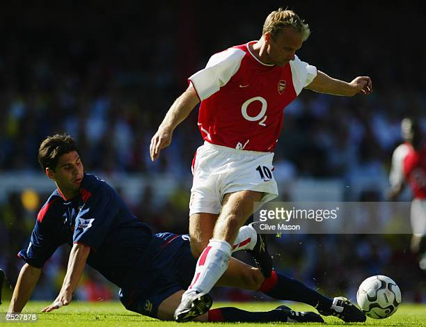 Dejan Stefanovic of Portsmouth tackles Dennis Bergkamp of Arsenal during the FA Barclaycard Premiership match between Arsenal and Portsmouth on...