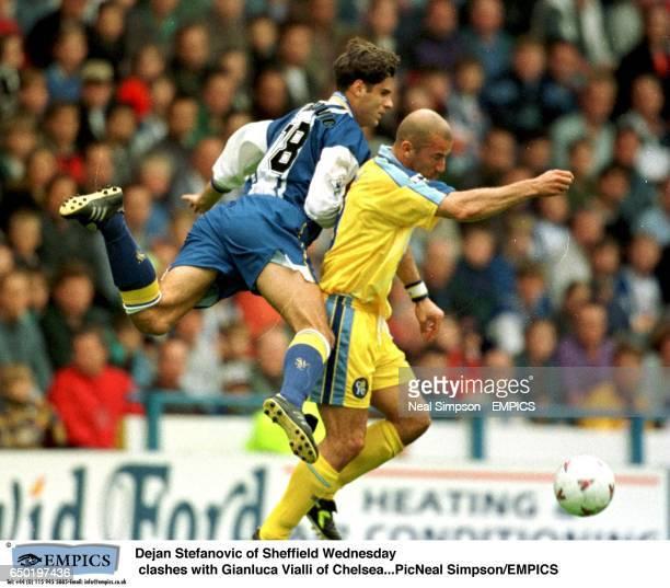 Dejan Stefanovic of Sheffield Wednesday clashes with Gianluca Vialli of Chelsea