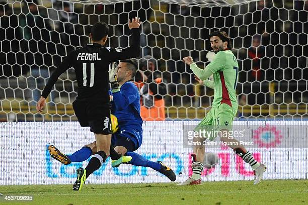 Dejan Stojanovic goalkeeper of Bologna FC saves his goal on Zoumair Agharbi Feddal of AC Siena during the Tim Cup match between FC Bologna and AC...