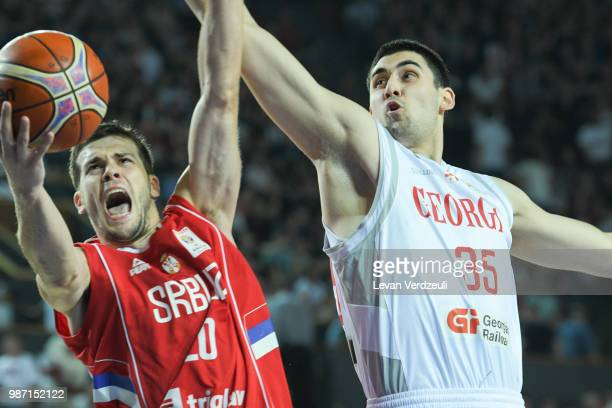 Dejan Todorovic of Serbia throws the ball while Goga Bitadze of Georgia tries to block it during the FIBA Basketball World Cup Qualifier match...