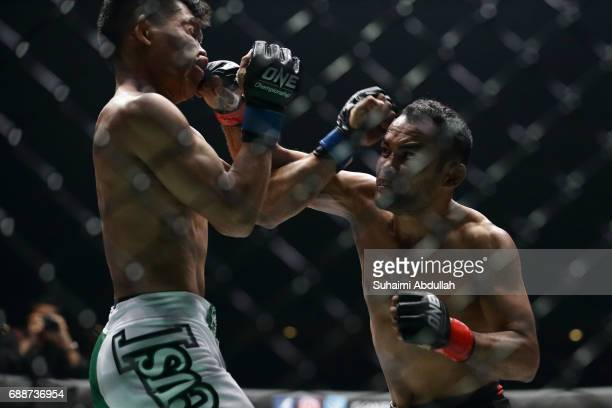Dejdamrong Soe Amnuaysirichoke of Thailand fights Adrian Matheis of Indonesia in the straw weight bout during the One Championship Dynasty of Heroes...