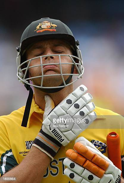 A dejected Adam Gilchrist walks off after being given out for 22 runs during the World Cup Semi Final Game between Sri Lanka and Australia at St...