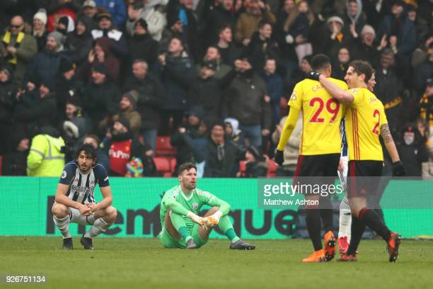 A dejected Ahmed Hegazy and Ben Foster of West Bromwich Albion after Watford scored the winning goal during in the Premier League match between...