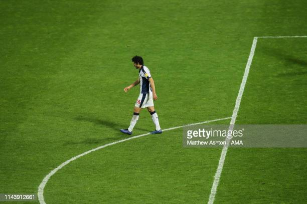 A dejected Ahmed Hegazy of West Bromwich Albion walks back after missing his penalty during the Sky Bet Championship Playoff Semi Final Second Leg...